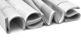 Newspapers folded to form the word NEWS