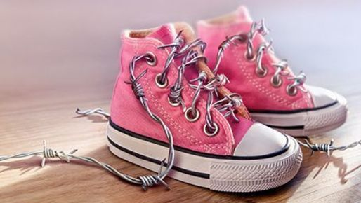 Children's shoes with barbed wire as a shoelace